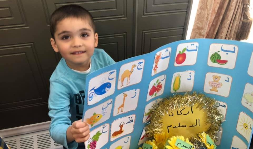 A child holds up a poster